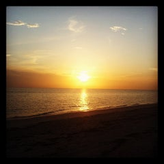 Photo taken at Bonita Beach by Eduardo H. on 7/6/2012