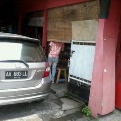 Photo taken at Tugu Adipura by adie p. on 12/16/2011