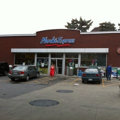 Photo taken at Esso - Marché Express Rosemont by Iain C. on 8/14/2011