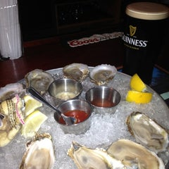 Photo taken at Tracks Raw Bar & Grill by Marcos E. on 5/20/2012