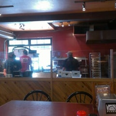 Photo taken at Woodstock's Pizza by Austin S. on 8/6/2012