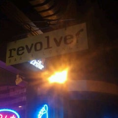 Photo taken at Revolver Bar & Lounge by Bryan B. on 6/30/2012