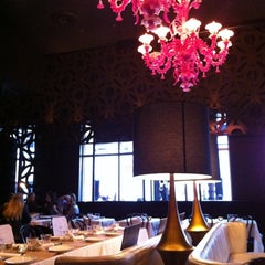 Photo taken at Society Dining Lounge by Austin S. on 5/12/2012