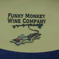 Photo taken at Funky Monkey Wine Company by Amy W. on 1/11/2012