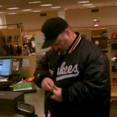 Photo taken at DSW Designer Shoe Warehouse by Norman T. on 12/17/2011