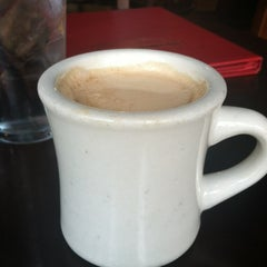 Photo taken at Metropolitan Coffeehouse & Wine Bar by Maia N. on 5/13/2012