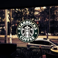 Photo taken at Starbucks by Mariana G. on 3/15/2012