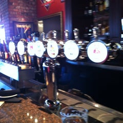 Photo taken at BJ's Restaurant and Brewhouse by Eric S. on 3/3/2012