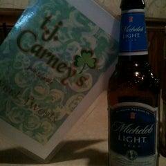 Photo taken at T. J. Carney's by Paula K. on 4/27/2012