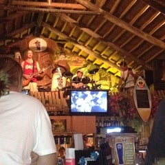 Photo taken at The Hut Bar and Grill by Billy C. on 5/13/2012