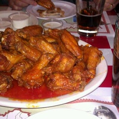 Photo taken at Pullanos Pizza & Wings by Tom K. on 12/24/2011