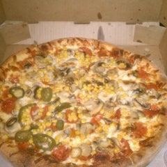 Photo taken at Laredo Pizza Factory by alex w. on 10/6/2011