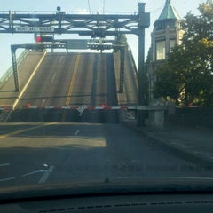 Photo taken at Montlake Bridge by Gina B. on 8/29/2011