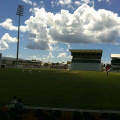 Photo taken at Kensington Oval by Jonathan C. on 2/18/2012