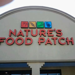 Photo taken at Nature's Food Patch Market & Cafè by Patricia N. on 12/14/2011