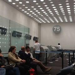 Photo taken at Sala/Gate 75 by Daniel O. on 3/2/2012