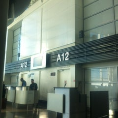 Photo taken at Gate A12 by Marius C. on 3/8/2012