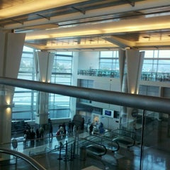 Photo taken at Gate A12 by Gaby F. on 12/12/2011