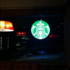 Photo taken at Starbucks by TJ C. on 7/26/2011