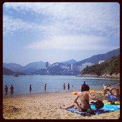 Photo taken at South Bay Beach 南灣泳灘 by Stephanie C. on 4/22/2012