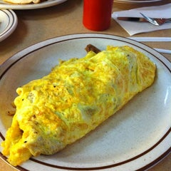 Photo taken at L George's Coney Island by Aimee A. on 12/2/2011