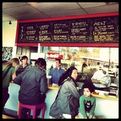 Photo taken at La Taqueria Pinche Taco Shop by Jennifer G. on 4/15/2012