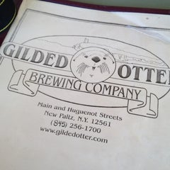 Photo taken at Gilded Otter Brewing Company by badcat d. on 8/22/2012