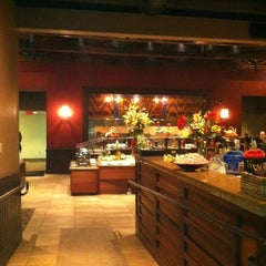 Photo taken at Rioz Brazilian Steakhouse by Jamie R. on 6/1/2012