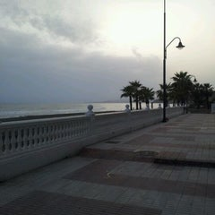 Photo taken at Paseo Marítimo de El Morche by Sandra J. E. on 3/23/2012