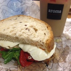 Photo taken at Aroma Espresso Bar by Built F. on 8/20/2012