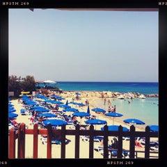 Photo taken at Konnos Beach by Галя Г. on 6/25/2012