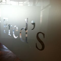 Photo taken at Fred's at Barneys New York by Lauren Y. on 8/5/2011