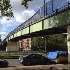 Photo taken at East 8th Street Footbridge by Justin W. on 6/5/2012