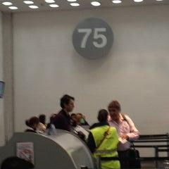 Photo taken at Sala/Gate 75 by Ruxe O. on 6/20/2012