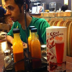 Photo taken at Nando's by Bakry B. on 3/16/2012