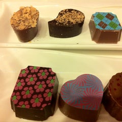 Photo taken at Lilly Handmade Chocolates by Abigail D. on 3/4/2012