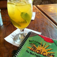 Photo taken at Raices Restaurant by Grisel S. on 2/3/2012