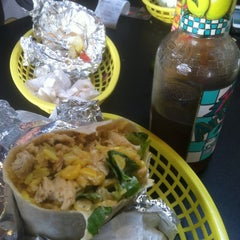 Photo taken at Machismo Burrito Bar by Julian I. on 12/28/2011