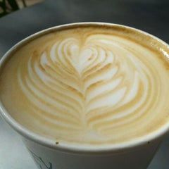 Photo taken at Press Coffee Roasters by Michelle on 4/21/2012