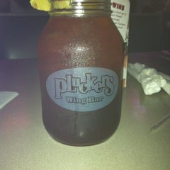 Photo taken at Pluckers Wing Bar by Dane H. on 12/4/2011