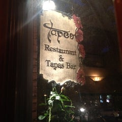 Photo taken at Tapeo Restaurant and Tapas Bar by Rock Reunion Clothing on 7/27/2012