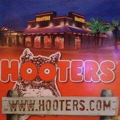 Photo taken at Hooters by Tom C. on 7/6/2012