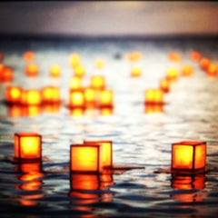 Photo taken at Memorial Day Lantern Floating Ceremony @ Ala Moana Beach Park by Kent N. on 5/29/2012