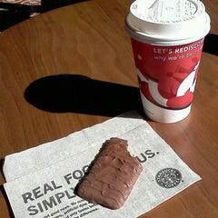 Photo taken at Starbucks by Daniela C. on 11/29/2011