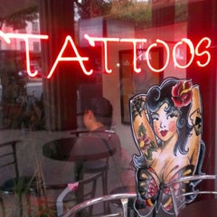 Photo taken at Evolution Tattoo by Isaac H. on 7/2/2012
