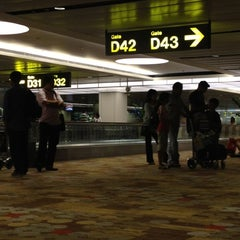 Photo taken at Gate D42 by pongsathorn w. on 4/19/2012