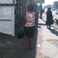Photo taken at Umoja Market by Sammzie N. on 2/26/2012