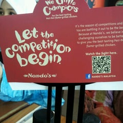 Photo taken at Nando's by Ommie Y. on 6/14/2012