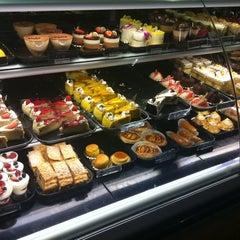 Photo taken at Porto's Bakery & Cafe by Sabrina L. on 9/24/2011