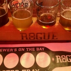 Photo taken at Rogue Brewers on the Bay by Katie M. on 12/29/2011